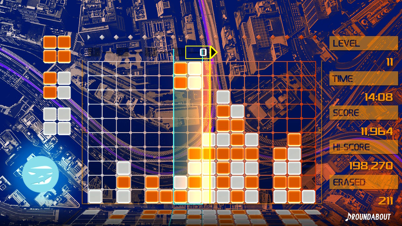 Gameplay of Lumines Remastered, in the middle of the orange and white skin Roundabout.